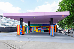 "© Licensed to London News Pictures. 01/06/2017. London, UK.  ""Here After"", a multi-coloured artwork adapting the colours of a television test card, by designers Craig & Karl, has been unveiled at a petrol station opposite the former BBC Television Centre in Wood Lane.  Photo credit : Stephen Chung/LNP"