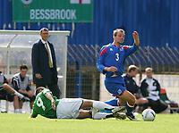 Photo: Andrew Unwin.<br /> Northern Ireland v Iceland. European Championships 2008 Qualifying. 02/09/2006.<br /> Northern Ireland's David Healy (L) slides in on Iceland's Indridi Sigurdsson (R).