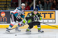 KELOWNA, CANADA -FEBRUARY 7: Madison Bowey #4 of the Kelowna Rockets checks Curtis Lazar #27 of the Edmonton Oil Kings on February 7, 2014 at Prospera Place in Kelowna, British Columbia, Canada.   (Photo by Marissa Baecker/Getty Images)  *** Local Caption *** Madison Bowey; Curtis Lazar;