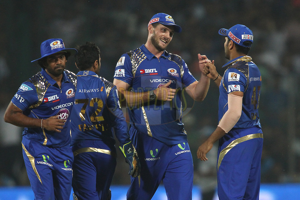 Mitchell McClenaghan of Mumbai Indians is congratulated by Mumbai Indians captain Rohit Sharma for getting Angelo Mathews of the Delhi Daredevils wicket during match 21 of the Pepsi IPL 2015 (Indian Premier League) between The Delhi Daredevils and The Mumbai Indians held at the Ferozeshah Kotla stadium in Delhi, India on the 23rd April 2015.<br /> <br /> Photo by:  Shaun Roy / SPORTZPICS / IPL