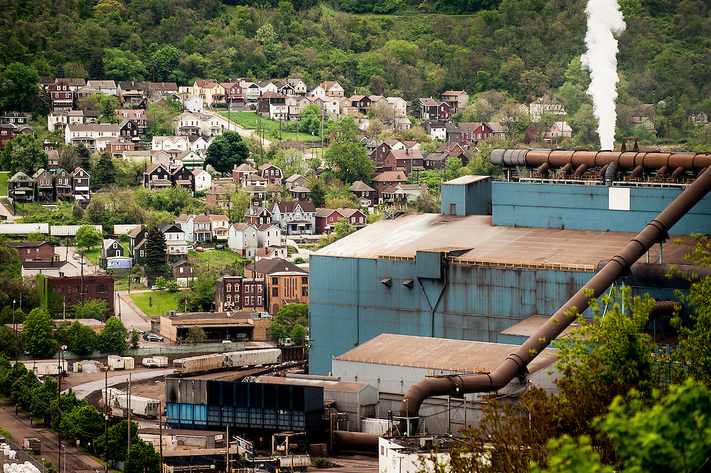 Homes in Braddock, PA are seen behind the Edgar Thompson Steel Works.<br />