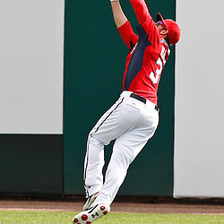 March 4, 2011; Viera, FL, USA; Washington Nationals right fielder Bryce Harper (34) makes a catch during a spring training exhibition game against the Atlanta Braves at Space Coast Stadium.  Mandatory Credit: Derick E. Hingle
