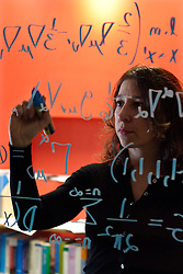 UK ENGLAND OXFORD 3DEC03 - Research Fellow in Astrophysics at Oxford University, Janna Levin writes a mathematical model on the glass wall of her office. Last year she published her first book titled 'How the Universe Got Its Spots' - Diary of a Finite Time in a Finite Space - in which she argues her mathematical model of a finite universe...jre/Photo by Jiri Rezac for GEO Wissen..© Jiri Rezac 2003..Contact: +44 (0) 7050 110 417.Mobile:   +44 (0) 7801 337 683.Office:    +44 (0) 20 8968 9635..Email:   jiri@jirirezac.com.Web:     www.jirirezac.com