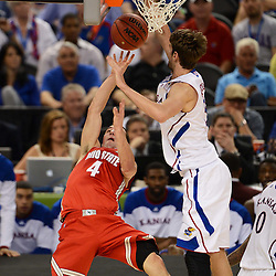Mar 31, 2012; New Orleans, LA, USA; Ohio State Buckeyes guard Aaron Craft (4) shoots as Kansas Jayhawks center Jeff Withey (5) defends during the first half in the semifinals of the 2012 NCAA men's basketball Final Four at the Mercedes-Benz Superdome. Mandatory Credit: Derick E. Hingle-US PRESSWIRE