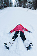 Girl creating a snow angel