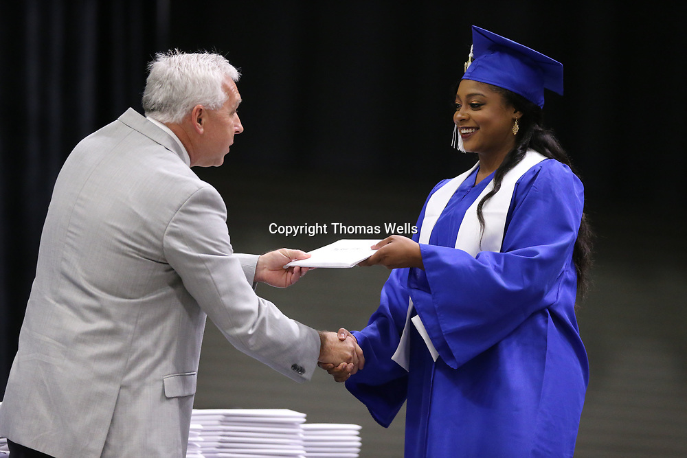 Markeela Fisk accpets her diploma from Saltillo High School Principal Tim DeVaughn on Saturday.