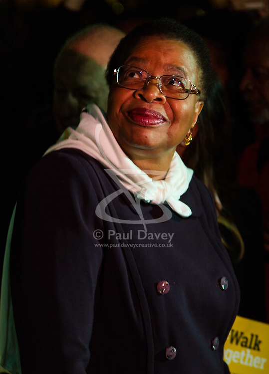 "London, October 23 2017. Nelson Mandela's group of Elders including former UN Secretary General Kofi Annan and Secretary General Ban Ki-moon accompanied by his widow Graca Machel gather at Parliament Square at the start of the Walk Together event in memory of Nelson Mandela before a candlelight vigil at his statue in Parliament Square. ""WalkTogether is a global campaign to inspire hope and compassion, celebrating communities working for the freedoms that unite us"". PICTURED: Graca Machel looks up at the statue of her late husband in Parliament Square. © Paul Davey"