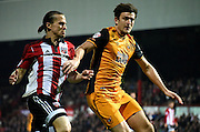 Harry Maguire and Lasse Vibe jockey each other for posession during the Sky Bet Championship match between Brentford and Hull City at Griffin Park, London, England on 3 November 2015. Photo by Michael Hulf.
