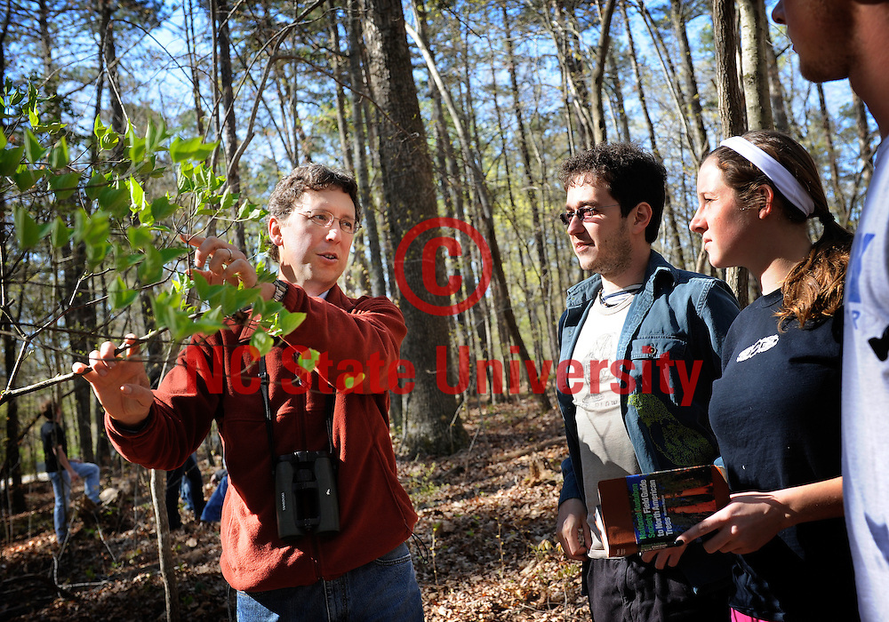 Dr. Nick Haddad works with students in the field at Yates Mill.  Photo by Marc Hall