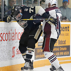 TRENTON, ON  - MAY 4,  2017: Canadian Junior Hockey League, Central Canadian Jr. &quot;A&quot; Championship. The Dudley Hewitt Cup. Game 6 between the Trenton Golden Hawks and The Dryden GM Ice Dogs.  Cory Dennis #12 of the Dryden GM Ice Dogs and Anthony Sorrentino #77 of the Trenton Golden Hawks battles for the puck during the second period <br /> (Photo by Amy Deroche / OJHL Images)