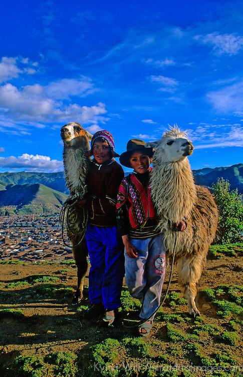 South America, Peru. Guardians of the llamas
