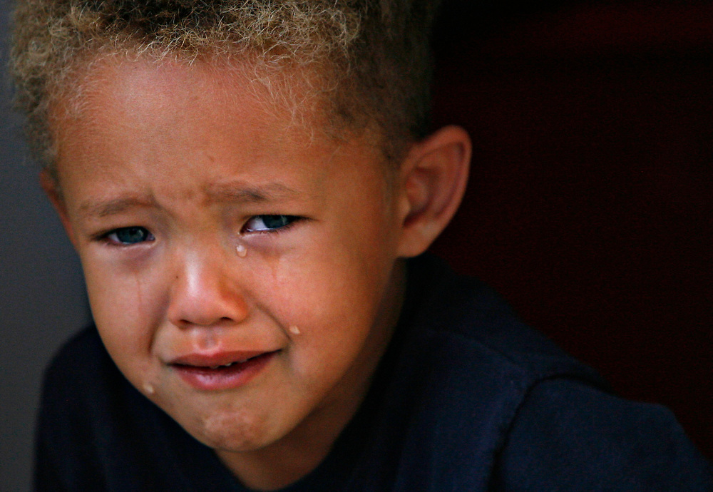 MELISSA LYTTLE   |   Times<br /> SP_345156_LYTT_MOTEL_3 (November 22, 2011, St. Petersburg, FL) Big, fat, sad tears roll down the face of Andre Hathaway, 4, after being told by his mom that they were all packed and it was now time to leave the Mosley Motel. Out of all the places Andre's family has bounced around to while being down on their luck, the Mosley was the first place with other families. With dozens of kids to play with at the motel, for Andre had made friends for the first time. His mom Laurie Hathaway said that's what he was saddest about leaving behind.  [MELISSA LYTTLE, Times]