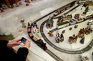 A visitor takes a picture of Santa's Christmas Train  during the Christmas Gathering at Polen Farm in Kettering, Sunday, December 25, 2011.
