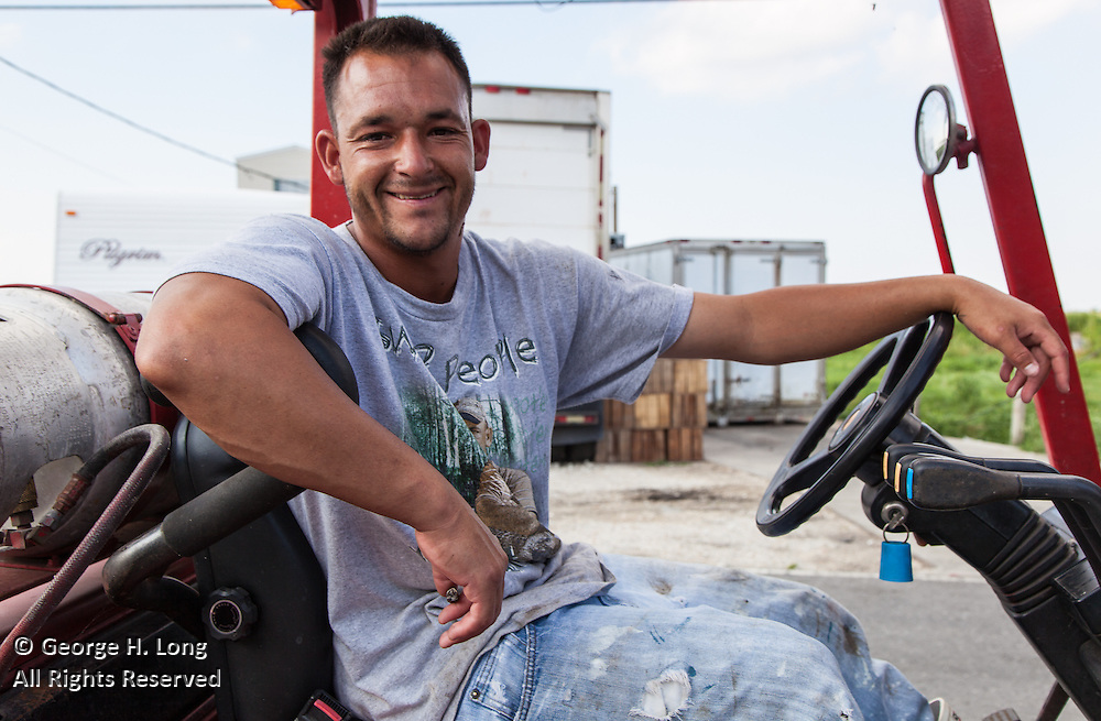 Lester Nunez operates a forklift in Shell Beach, Louisiana to load an 18-wheeler full with crabs bound for Maryland every day
