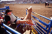 24 FEBRUARY 2002, TUCSON, ARIZONA, USA: Darren Clarke leaves the chute atop the bronc Masher in the finals at the Fiesta de los Vaqueros Rodeo in Tucson, Az, Sunday, Feb. 24, 2002. The Fiesta de los Vaqueros Rodeo has been held for 77 years and is one of the largest professional rodeos in the US..PHOTO BY JACK KURTZ