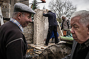 "Members of the municipal council set up a sculpted headstone WWI memorial, on November 9, 2015 in Parigny-la-Rose. Nearly one hundred years after WWI, the small village of Parigny-la -Rose, south of Auxerre, make amends and honours its four forgotten WWI French ""poilus"" soldiers killed in action, with a memorial that will be ready in time for the WWI commemorations. AFP PHOTO / JEFF PACHOUD"