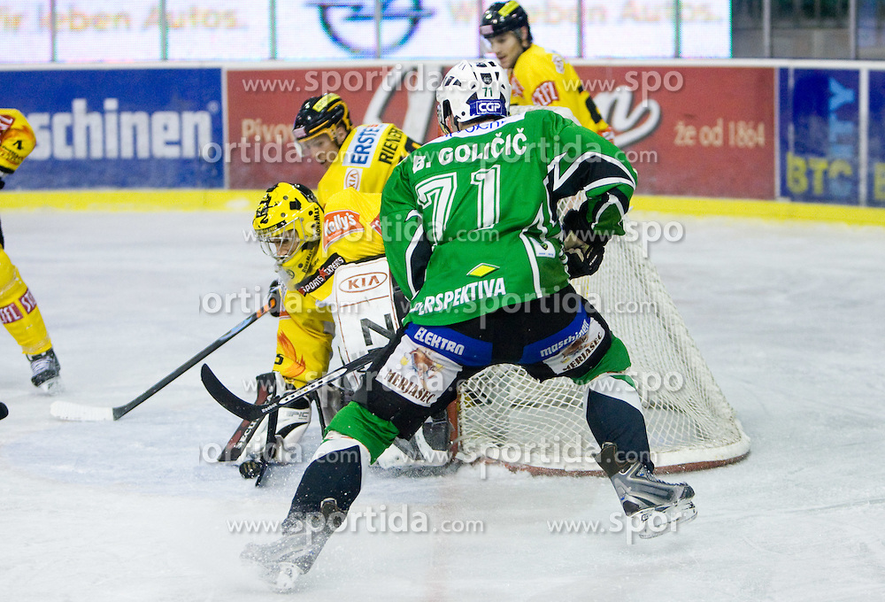 Goalkeeper Frederic Cassivi and Bostjan Golicic of Olimpija during 52nd Round of EBEL league ice-hockey match between HDD Tilia Olimpija, Ljubljana and EV Vienna Capitals, on February 7, 2010 in Arena Tivoli, Ljubljana, Slovenia. Vienna defeated Olimpija 8-2. (Photo by Vid Ponikvar / Sportida)