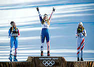 USA's Lindsey Vonn, center, clebrates winning the gold medal along with silver medalist Julie Mancuso, left, and bronze medalist Elisabeth Goergl, of Austria, after winning the ladies' downhill Wednesday in Whistler, B.C. during the 2010 Olympic Winter Games.