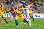 March 28 2017: Socceroos Milos DEGENEK (2) gets a push from United Arab Emirates Ismail AL HAMMADI (15) at the 2018 FIFA World Cup Qualification match, between The Socceroos and UAE played at Allianz Stadium in Sydney.