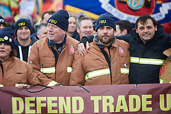 © Licensed to London News Pictures.  09/12/2014. AYLESBURY, UK. Thousands of fire fighters march through Aylesbury during the latest  nationwide strike of Fire Brigade Union members over pension rights. the union is also intending to take legal action over the dismissal of Ricky Matthews by the Buckinghamshire and Milton Keynes Fire Authority for taking part in pervious industry action. <br /> <br /> In this picture: Matt Wrack, FBU general secretary (centre left holding banner) and sacked firefighter Ricky Matthews (2nd right holding banner)<br /> <br /> <br /> Photo credit: Cliff Hide/LNP