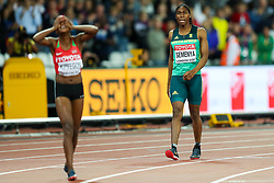 London, 2017 August 07. Caster Semenya, South Africa's bronze winner, looks on as Faith Chepngetich Kipyegon, Kenya, celebrates her gold medal in the women's 1,500m final on day four of the IAAF London 2017 world Championships at the London Stadium. © Paul Davey.