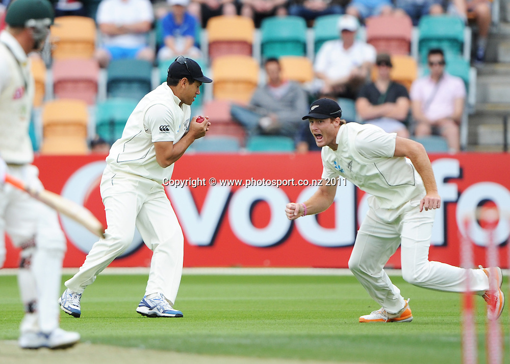 Ross Taylor takes a catch to dismiss David Warner on Day 2 of the second cricket test between Australia and New Zealand Black Caps at Bellerive Oval in Hobart, Saturday 10 December 2011. Photo: Andrew Cornaga/Photosport.co.nz
