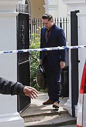 © licensed to London News Pictures.  28/07/2011. London, UK. Reg Traviss, boyfriend on Amy WInhouse leaving Amy's home in Camden, North London toady (28/07/2011) carrying personal items belonging to the  singer. Photo credit: Ben Cawthra/LNP