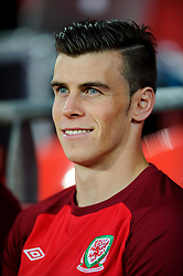 Gareth Bale of Wales (Real Madrid) looks on from the bench before the match - Photo mandatory by-line: Rogan Thomson/JMP - Tel: Mobile: 07966 386802 10/09/2013 - SPORT - FOOTBALL - Cardiff City Stadium - Cardiff -  Wales V Serbia- World Cup Qualifier.