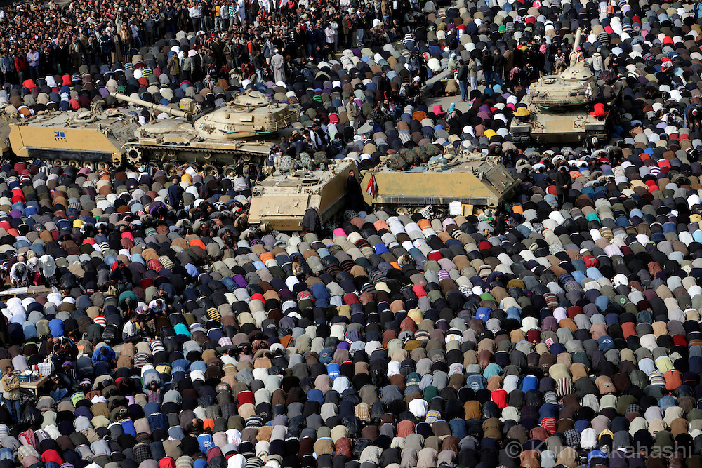 Anti-government protesters pray at Tahrir Sq in Cairo Egypt on Feb 11, 2011 during the 18th-day protest demanding President Hosni Mubarak to step down. .Photo by Kuni Takahashi