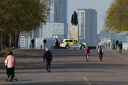 © Licensed to London News Pictures. 27/03/2020. London, UK. Police patrol Greenwich Park and instruct people who aren't exercising to move on. The Government has announced a lockdown to slow the spread of Coronavirus and reduce pressure on the NHS. Photo credit: George Cracknell Wright/LNP