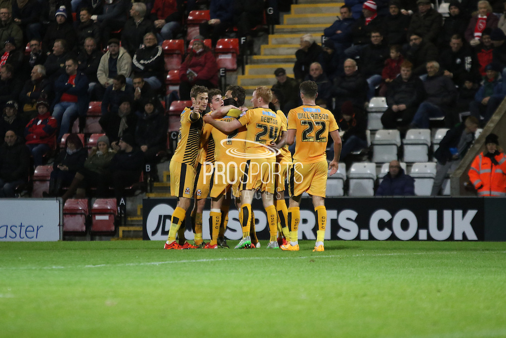 Cambridge players celebrate during the Sky Bet League 2 match between Morecambe and Cambridge United at the Globe Arena, Morecambe, England on 24 November 2015. Photo by Pete Burns.