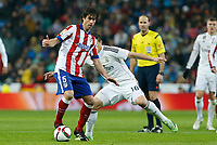 Real Madrid´s James Rodriguez (B) and Atletico de Madrid´s Tiago Cardoso during Spanish King´s Cup match at Santiago Bernabeu stadium in Madrid, Spain. January 15, 2015. (ALTERPHOTOS/Victor Blanco)