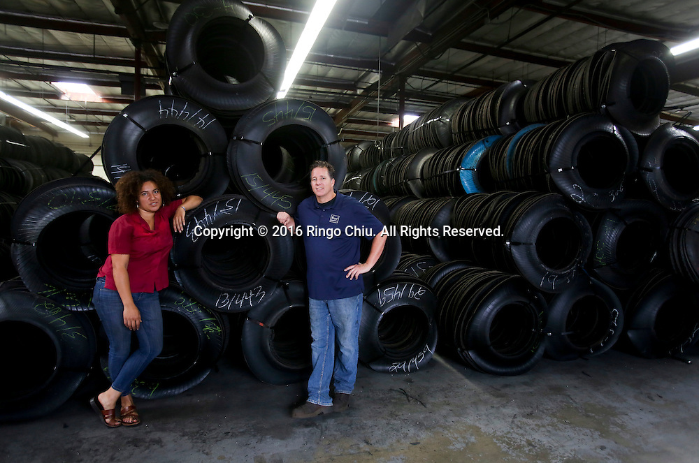 Niki Okuk and Richard Carter, co-founders of RCO Material Reuse, a factory cuts and molds tires into new products such loading dock bumpers and parking barriers.<br /> (Photo by Ringo Chiu/PHOTOFORMULA.com)<br /> <br /> Usage Notes: This content is intended for editorial use only. For other uses, additional clearances may be required.