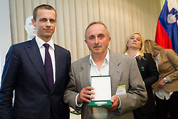 Aleksander Ceferin, president of NZS with Ludvik Fabris, honored worker in Slovenian football during General Assembly of  Football Association of Slovenia - NZS, on April 19, 2012 in Hotel Kokra, Brdo pri Kranju, Slovenia.  (Photo by Vid Ponikvar / Sportida.com)