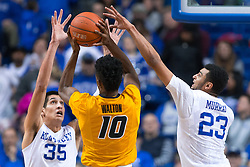 Kentucky forward Derek Willis, left, and guard Jamal Murray defend a shot by Missouri guard K.J. Walton in the second half. <br /> <br /> The University of Kentucky hosted the University of Missouri, Wednesday, Jan. 27, 2016 at Rupp Arena in Lexington.