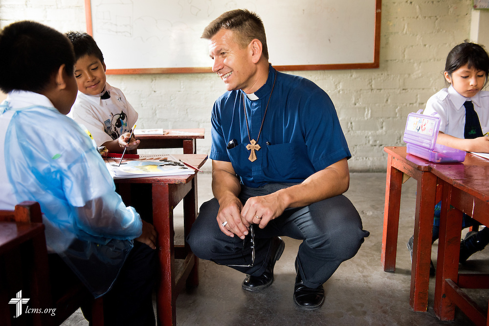 The Rev. Mark Eisold, LCMS career missionary to Peru, visits with a student at the Noe (Spanish for Noah) school, one of many places affected by recent landslides near Lima, Peru, on Tuesday, April 7, 2015. LCMS Communications/Erik M. Lunsford
