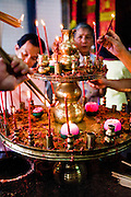 Goddess of Mercy Temple candles to light incense sticks.