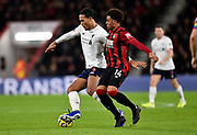 Virgil van Dijk (4) of Liverpool battles for possession with Arnaut Danjuma (14) of AFC Bournemouth during the Premier League match between Bournemouth and Liverpool at the Vitality Stadium, Bournemouth, England on 7 December 2019.