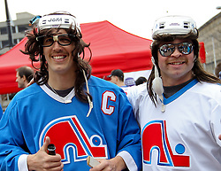 Apr 10; Newark, NJ, USA; Fans of the former NHL franchise, the Quebec Nordiques rally outside the Prudential Center before the game between the New Jersey Devils and the Boston Bruins.
