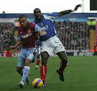 Photo: Lee Earle.<br /> Portsmouth v Aston Villa. The Barclays Premiership. 02/12/2006. Villa's Gabriel Agbonlahor (L) battles with Sol Cambell.