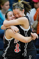 Priest River High's Holly Hirst, left, and Kelsey Bradbury celebrate their teams win over Fruitland High at 3A state basketball consolation championship game Saturday in Nampa.