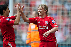LIVERPOOL, ENGLAND - Saturday, April 23, 2011: Liverpool's Dirk Kuyt celebrates scoring his side's second goal against Birmingham City with team-mate Luis Alberto Suarez Diaz during the Premiership match at Anfield. (Photo by David Rawcliffe/Propaganda)
