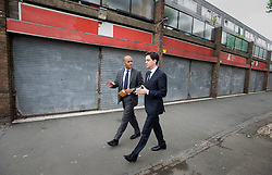 © licensed to London News Pictures. 13/06/2011. London, UK. Labour leader Ed Miliband talking to locals at The Community Hub on the Blenheim Gardens in Brixton South London today (13/06/2011). Pictured leaving with Chuka Umunna,  Member of Parliament for Streatham.  Photo credit should read: Ben Cawthra/LNP