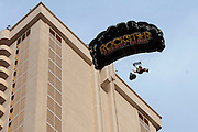 Erik Roner of Nitro Circus is seen base jumping off The Signature at the MGM Grand Hotel & Casino on Wednesday June 1, 2011 in Las Vegas to promote the North American debut of Nitro Circus Live at the MGM Grand Garden Arena on Saturday June 4, 2011. (Jeff Bottari/AP Images for Nitro Circus Live)
