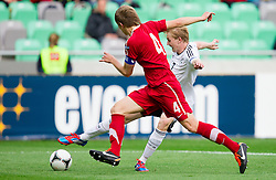 Gracjan Horoszkiewicz of Poland vs Julian Brandt of Germany during the UEFA European Under-17 Championship Semifinal match between Germany and Poland on May 13, 2012 in SRC Stozice, Ljubljana, Slovenia. Germany defeated Poland 1-0 and qualified to finals. (Photo by Vid Ponikvar / Sportida.com)