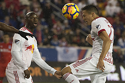 March 1, 2018 - Harrison, New Jersey, United States - New York Red Bulls midfielder SEAN DAVIS (27) heads the ball in front of New York Red Bulls forward BRADLEY WRIGHT-PHILLIPS (99) during the CONCACAF Champions league match at Red Bull Arena in Harrison, NJ.  NY Red Bulls defeat CD Olimpia 2-0  (Credit Image: © Mark Smith via ZUMA Wire)