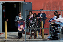 A small group is seen leaving after meeting Republican candidate Donald Trump as he attended a at a September 2, 2016 private event with Republican, African-American voters in North Philadelphia, Pennsylvania
