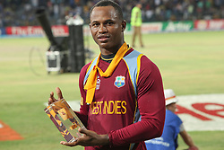 © Licensed to London News Pictures. 07/10/2012. Man of the match West Indian Marlon Samuels during the World T20 Cricket Mens Final match between Sri Lanka Vs West Indies at the R Premadasa International Cricket Stadium, Colombo. Photo credit : Asanka Brendon Ratnayake/LNP