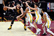 Jun 6, 2018; Cleveland, OH, USA; Cleveland Cavaliers center Kevin Love (0) handles the ball against Golden State Warriors forward Andre Iguodala (9) and Golden State Warriors guard Klay Thompson (11) during the third quarter in game three of the 2018 NBA Finals at Quicken Loans Arena.