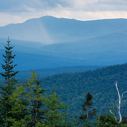 A summer rain shower on Mount Blue as seen from Farmer Mountain in Mount Abram Township, Maine
